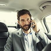 Man on phone in a comfy car